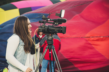 woman operating a video camera
